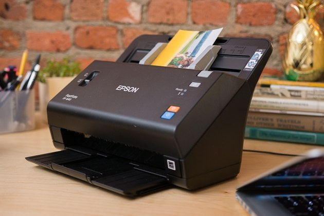 can you insert document stapled document into portable scanner